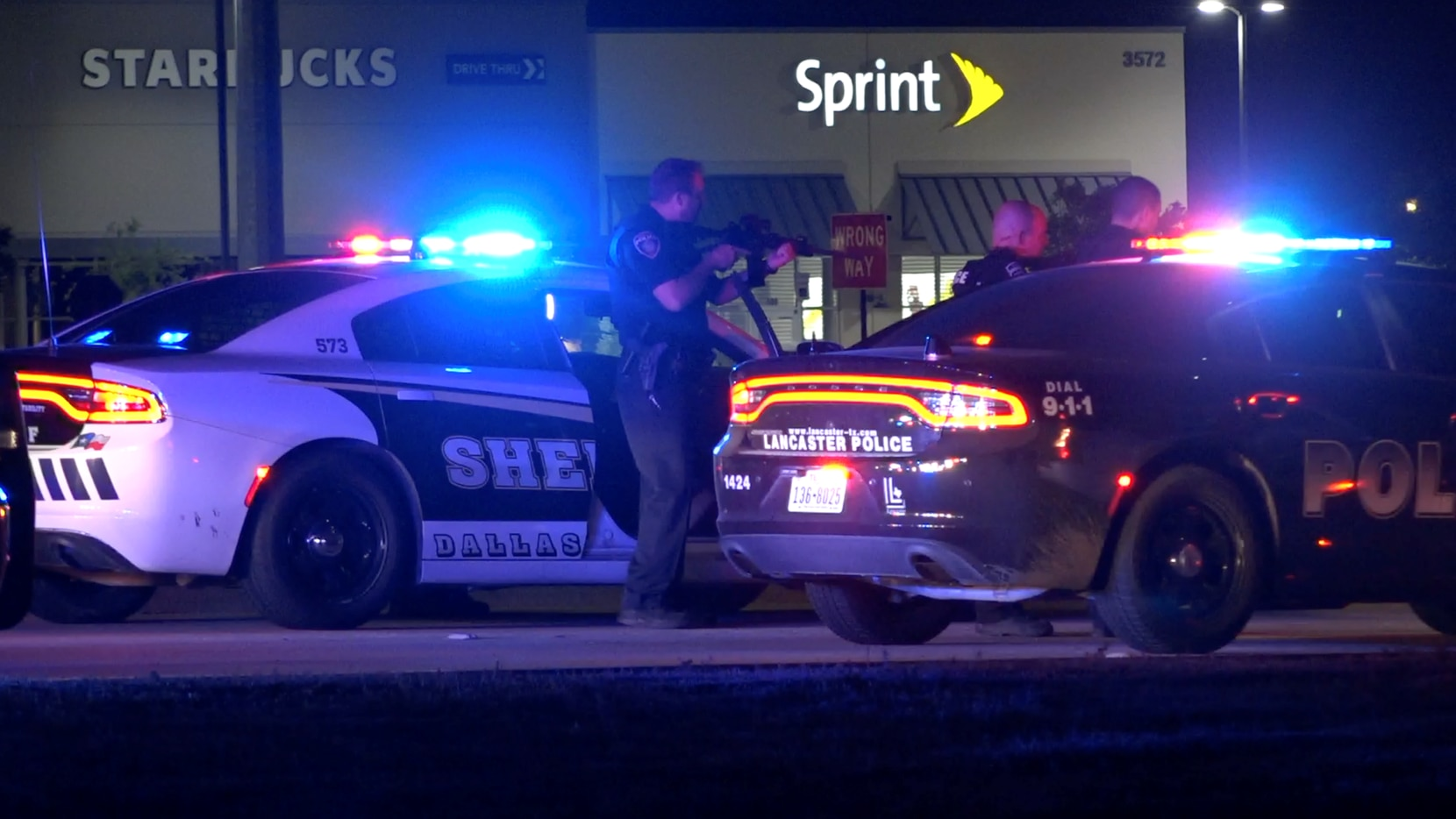 Lancaster police officers converge on a suspect that led them on a chase into Tarrant County near Texas Motor Speedway on Wednesday morning.