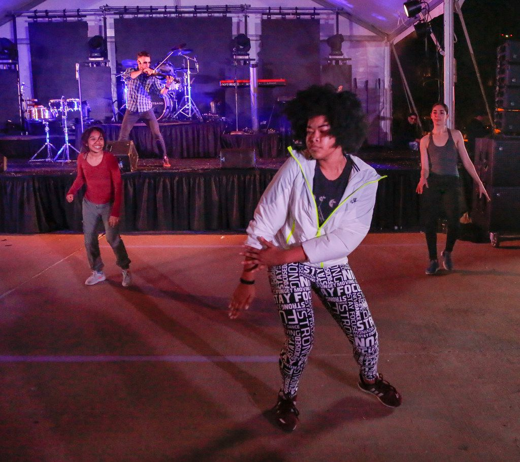 Booker T. Washington High School for the Visual & Performing Arts dancers from left, Alma Alvarado, Jade Pierre and Eden Ryder perform with Svet at the Texas Scottish Rite Hospital for Children fundraiser Treasure Street Thursday, October 19, 2017. Svet, an electric hip hop violinist from America's Got Talent was part of the entertainment for the Dallas hospital. (Ron Baselice/The Dallas Morning News)