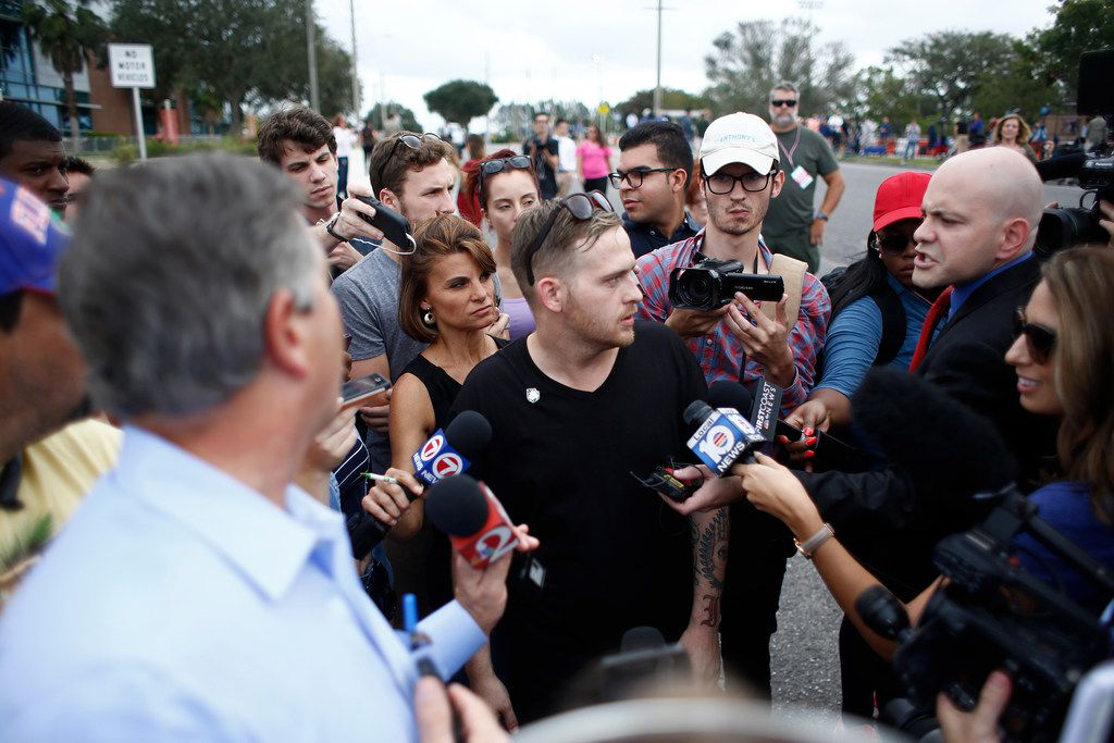 Self-described white nationalist Colton Fears, of Pasadena, Texas, speaks to members of the media as demonstrators gather near the site of a planned speech by Richard Spencer, who popularized the term 'alt-right',  at the University of Florida campus on October 19, 2017 in Gainesville, Florida. Fears was later arrested, along with his brother William Fears and friend Tyler Tenbrink, in relation to a shooting following the speech.