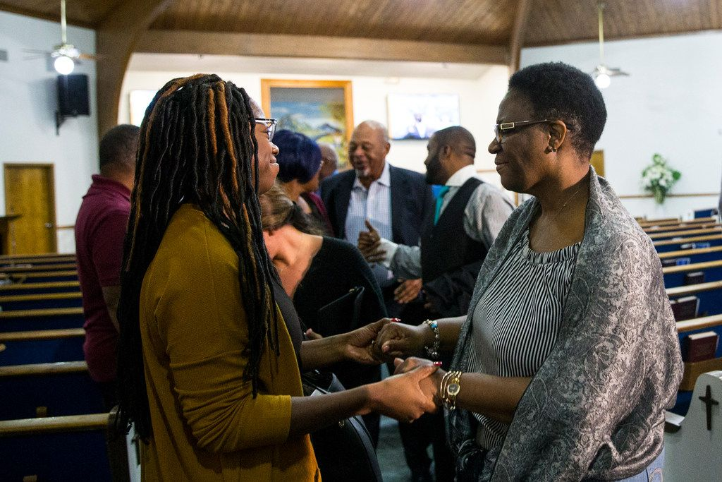 Allison Jean talks to her son's friend Joy Oparaodu following a prayer vigil for Botham Shem Jean at the Dallas West Church of Christ on Saturday, Sept. 8, in Dallas. He was shot by a Dallas police officer in his apartment on Thursday night.