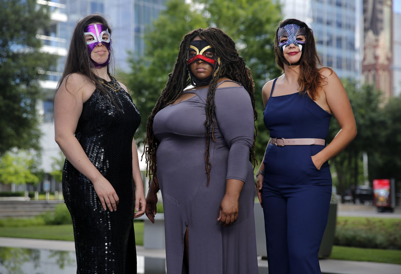 Tiffany Lang, center, was cast as Coyol in Prism Movement Theater's recent production of 'Lucha Teotl,' a new play that takes the form of a Mexican lucha libre pro-wrestling storyline, but later left the production. Lang poses in the Dallas Arts District with Jennifer Ramirez and Tatiana Lucia Gantt, who also portray masked luchadores, on July 2.