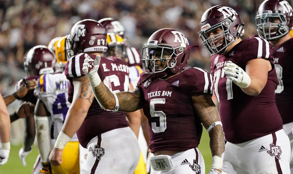 Texas A&M's Trayveon Williams (5) celebrates after rushing for a touchdown against LSU during the first half of an NCAA college football game Saturday, Nov. 24, 2018, in College Station, Texas. (AP Photo/David J. Phillip)
