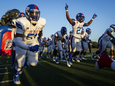 Duncanville players, including defensive lineman Josiah Drake (51) and running back Kaleb Kenney (27), take the field before their season-opening game against Mater Dei (Calif.) on Aug. 27, 2021, in Duncanville. (Smiley N. Pool/The Dallas Morning News)