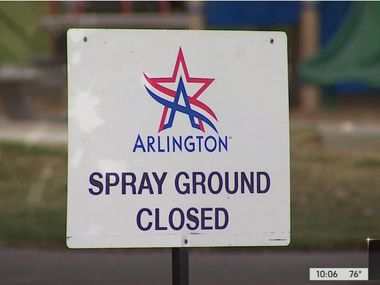 In this screen grab from KXAS-TV (NBC5), a sign indicates that an Arlington splash pad is closed after a child died from a rare infection caused by an amoeba likely contracted at Don Misenhimer Park.