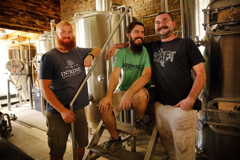 Intrinsic Smokehouse & Brewery owner Cary Hodson (center), his brother-in-law and business partner Casey Vincent (left) and pit master Tex Morgan pose for a photo in the brewery portion of Intrinsic Smokehouse & Brewery being renovated from a 1910 building in the downtown Garland square, Tuesday October 13, 2015.