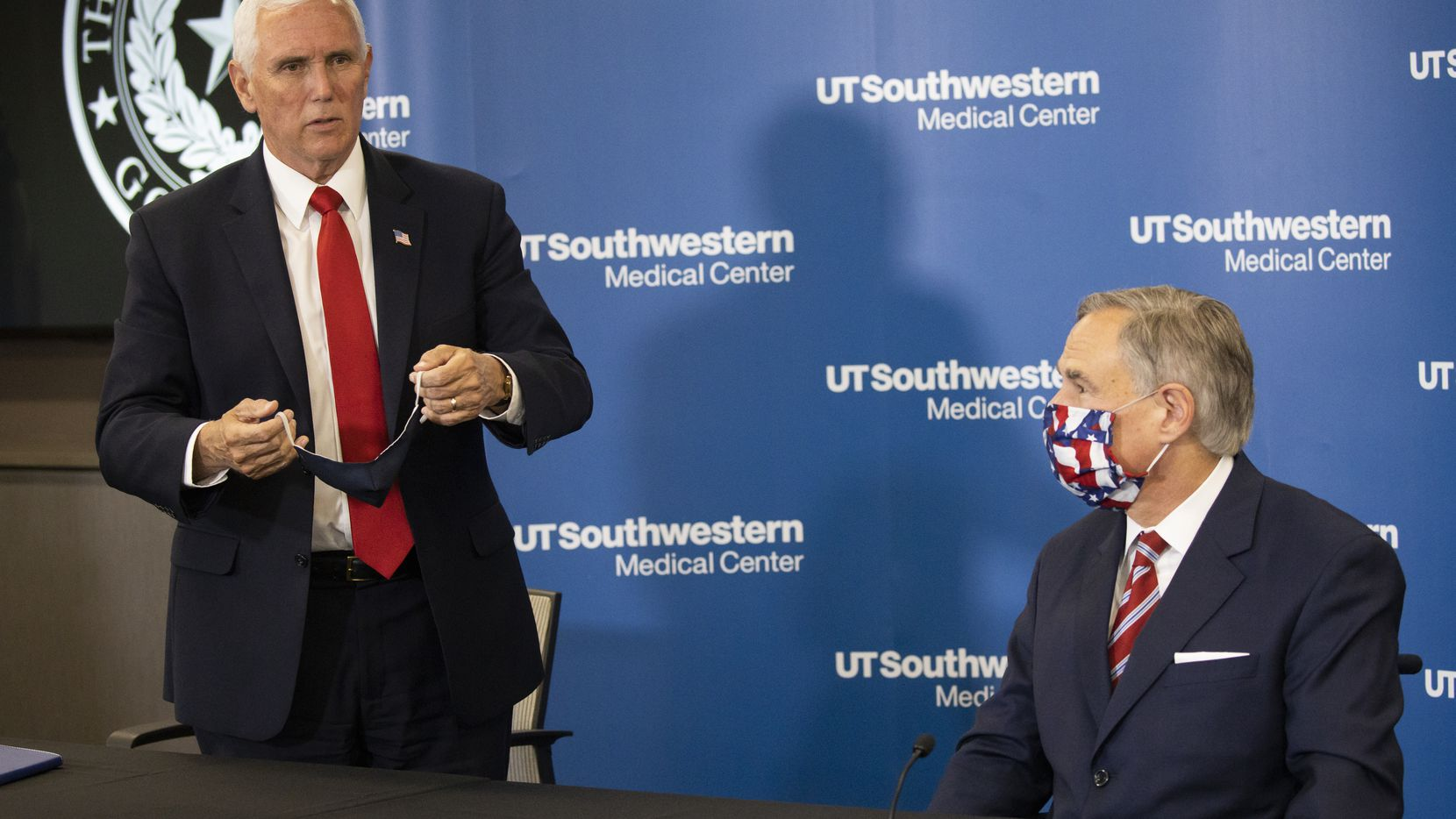 Vice President Mike Pence (left) prepares to leave following a press gaggle on the coronavirus pandemic with Gov. Greg Abbott at University of Texas Southwestern Medical Center on June 28, 2020, in Dallas.