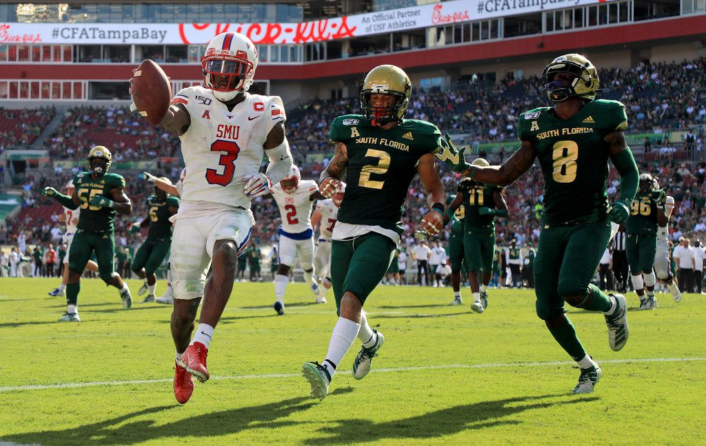 TAMPA, FLORIDA - SEPTEMBER 28: James Proche #3 of the Southern Methodist Mustangs scores a touchdown during a game against the South Florida Bulls at Raymond James Stadium on September 28, 2019 in Tampa, Florida. (Photo by Mike Ehrmann/Getty Images)