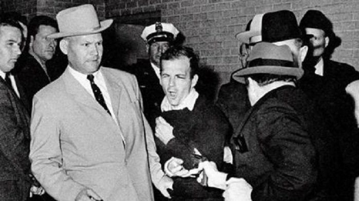 Jack Ruby shoots Lee Harvey Oswald, who was handcuffed to Dallas police Detective Jim Leavelle (in the light suit) in Dallas, Nov. 24, 1963. (Robert H. Jackson / digital file)