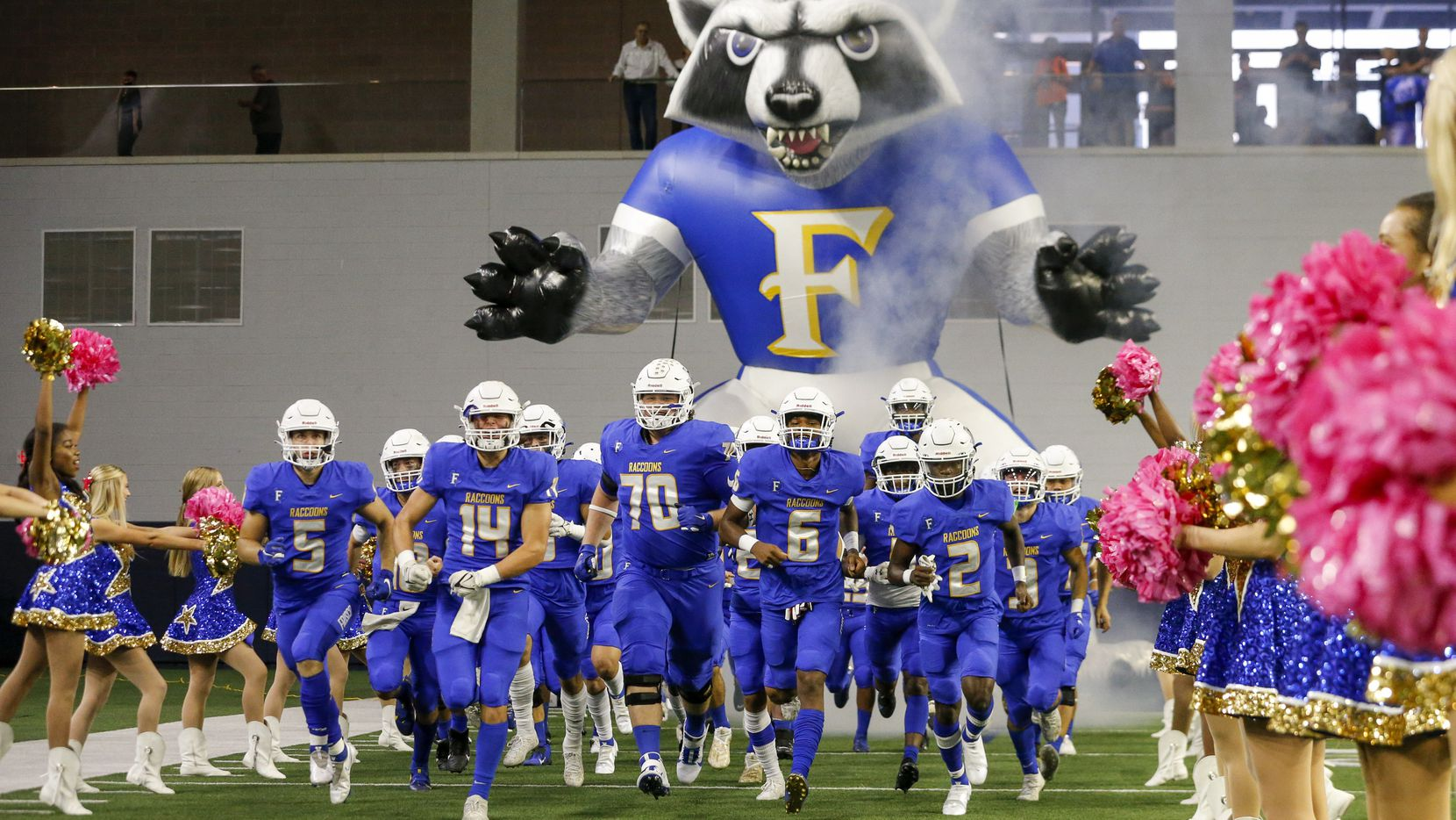 The Frisco football team takes the field before the first half of a high school football game against Frisco Liberty at The Ford Center on Friday, Oct. 1, 2021, in Frisco, Texas. (Elias Valverde II/The Dallas Morning News)