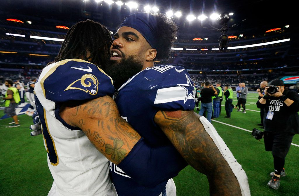 FILE - Todd Gurley (left) congratulates Ezekiel Elliott (center) on the Cowboys' win at AT&T Stadium in Arlington on Sunday, Dec. 15, 2019. The Cowboys beat the LA Rams 44-21.