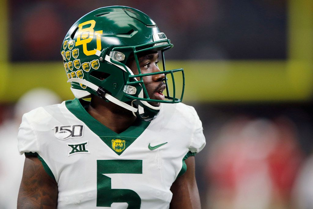 FILE - Baylor wide receiver Denzel Mims (5) is pictured during warmups before facing Oklahoma in the Big 12 Championship at AT&T Stadium in Arlington on Saturday, Dec. 7, 2019.