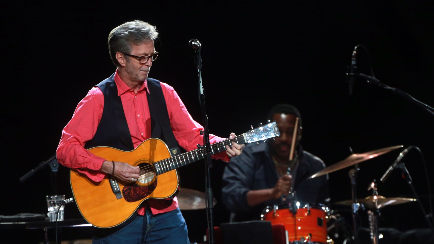 A 2013 file photo shows Eric Clapton performing at American Airlines Center. On Monday, Clapton played his first tour date since the onset of the pandemic at Dickies Arena in Fort Worth.