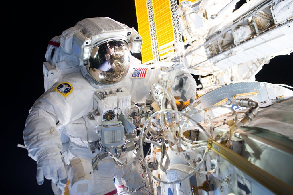 Expedition 48 Commander Jeff Williams installs the first of two international docking adapters during a six-hour spacewalk.