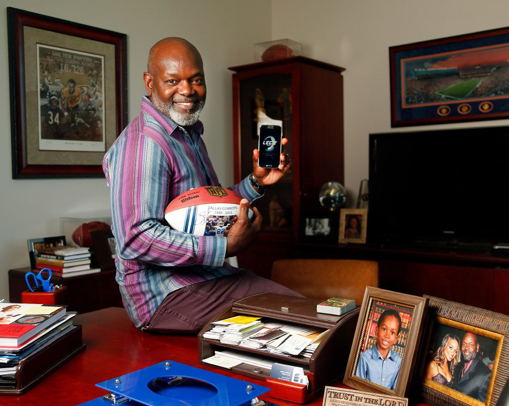 Dallas Cowboys Hall of Fame running back Emmitt Smith shows his football embedded with a chip that can be scanned for more information about that item. For example, a chip in a football jersey could tell you about the games in which it was worn.