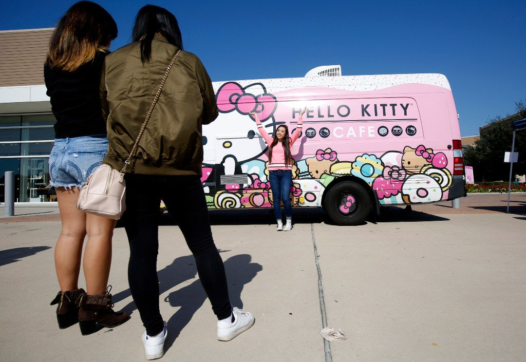 Fans posed for pictures with the Hello Kitty food truck at The Shops at Willow Bend in Plano, Texas, Saturday, Nov. 12, 2016.
