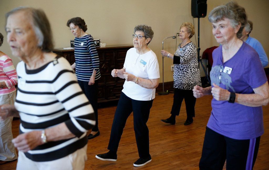 Louise Pierson (center) dances with her group during a line dancing class for seniors at Atria Canyon Creek in Plano