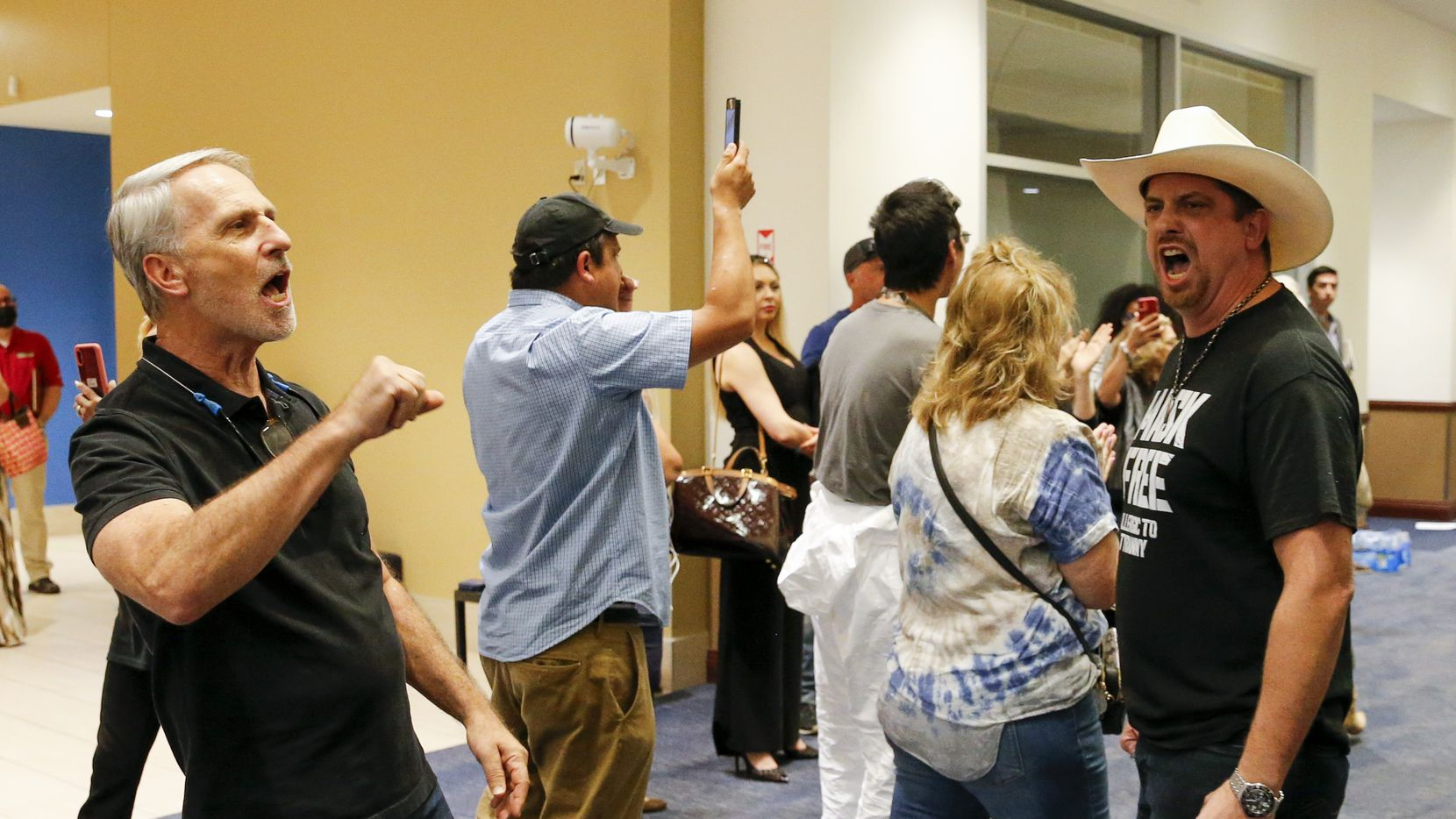 Opponents of mask mandates chant to be let in during a Dallas ISD school board meeting closed session on Thursday, Aug. 26, 2021, in Dallas. (Elias Valverde II/The Dallas Morning News)
