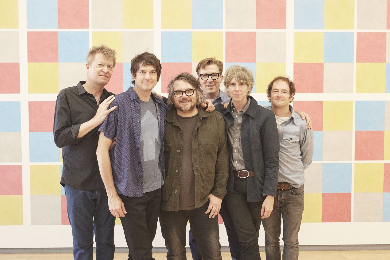 Jeff Tweedy, third from left, poses with members of the band Wilco.