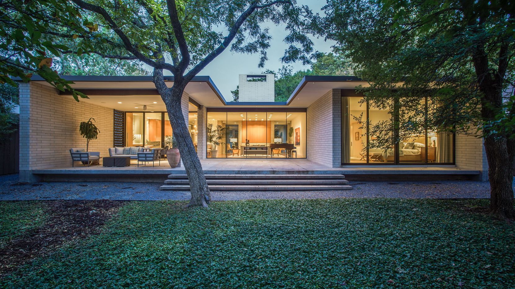 The three-bedroom custom contemporary design at 4603 Bluffview Blvd. is situated on a wooded half-acre.