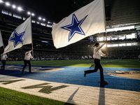 The Dallas Cowboys flag team flies through the end zone following a first half touchdown in an NFL matchup between the Dallas Cowboys and the Los Angeles Rams on Sunday, Dec. 15, 2019, at AT&T Stadium in Arlington, Texas.