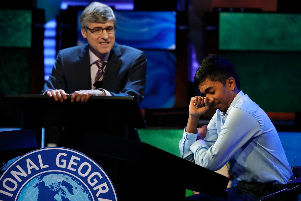Host Mo Rocca watches at left as Pranay Varada, 14, of Carrollton, Texas reacts after winning the 2017 National Geographic Bee, Wednesday, May 17, 2017, at the National Geographic Society in Washington. (AP Photo/Jacquelyn Martin)