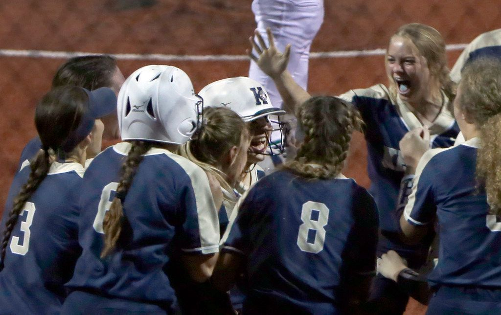 Keller's Hailey Jones (center) shares her elation with her teammates as she is mobbed at home plate after her two-run home run in the top of the sixth inning broke a 1-1 tie in Keller's 4-3 victory over Northwest Eaton on Friday. (Steve Hamm/ Special Contributor)
