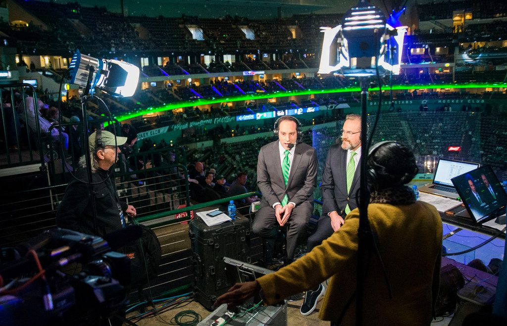 "From left, audio assistant Malcolm Johnson, play-by-play announcers Josh Bogorad and Daryl ""Razor"" Reaugh, and stage manager René Young conduct a practice run before covering the hockey game between the Dallas Stars and the Vancouver Canucks at the American Airlines Center in Dallas on Sunday, March 17, 2019."