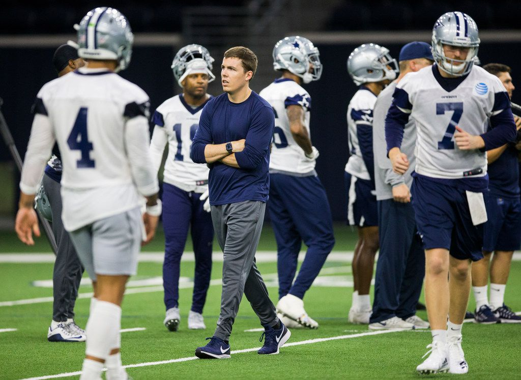 Dallas Cowboys offensive coordinator Kellen Moore (center) coaches during a Dallas Cowboys OTA practice on Wednesday, May 29, 2019 at The Star in Frisco. (Ashley Landis/The Dallas Morning News)