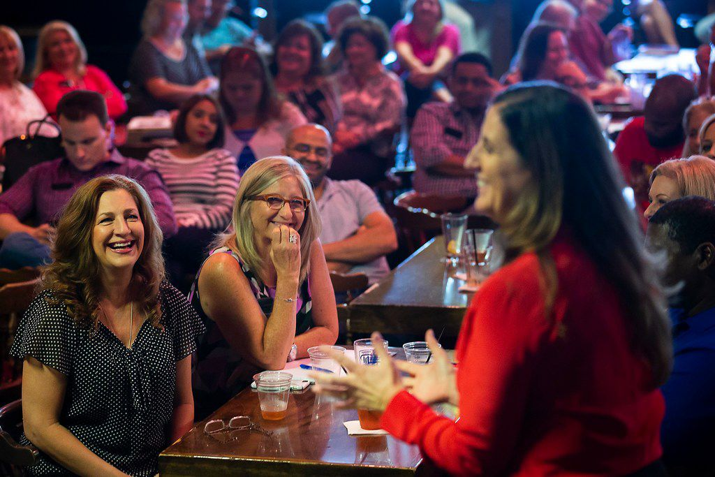 """Fathom Realty agents Jillian Hawkins Zhorne (left) and Paula Turner (center) listen to a presentation by attorney K. Annette Disch during what the company calls a  """"HAPPY/ Class,"""" a training session followed by a social hour at  Sherlocks Baker Street Pub in Addison."""