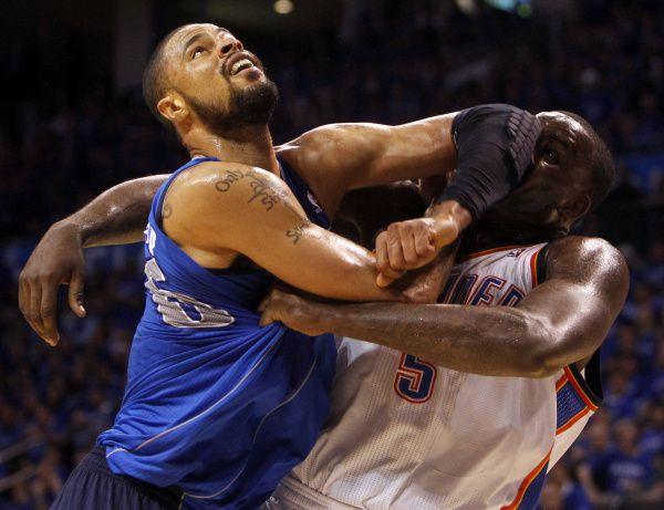 Dallas Mavericks center Tyson Chandler (6) and Oklahoma City Thunder center Kendrick Perkins (5) fight for position during the third quarter of play in Game 4 of the NBA Western Conference Finals at Oklahoma City Arena in Oklahoma City, on May 23, 2011.