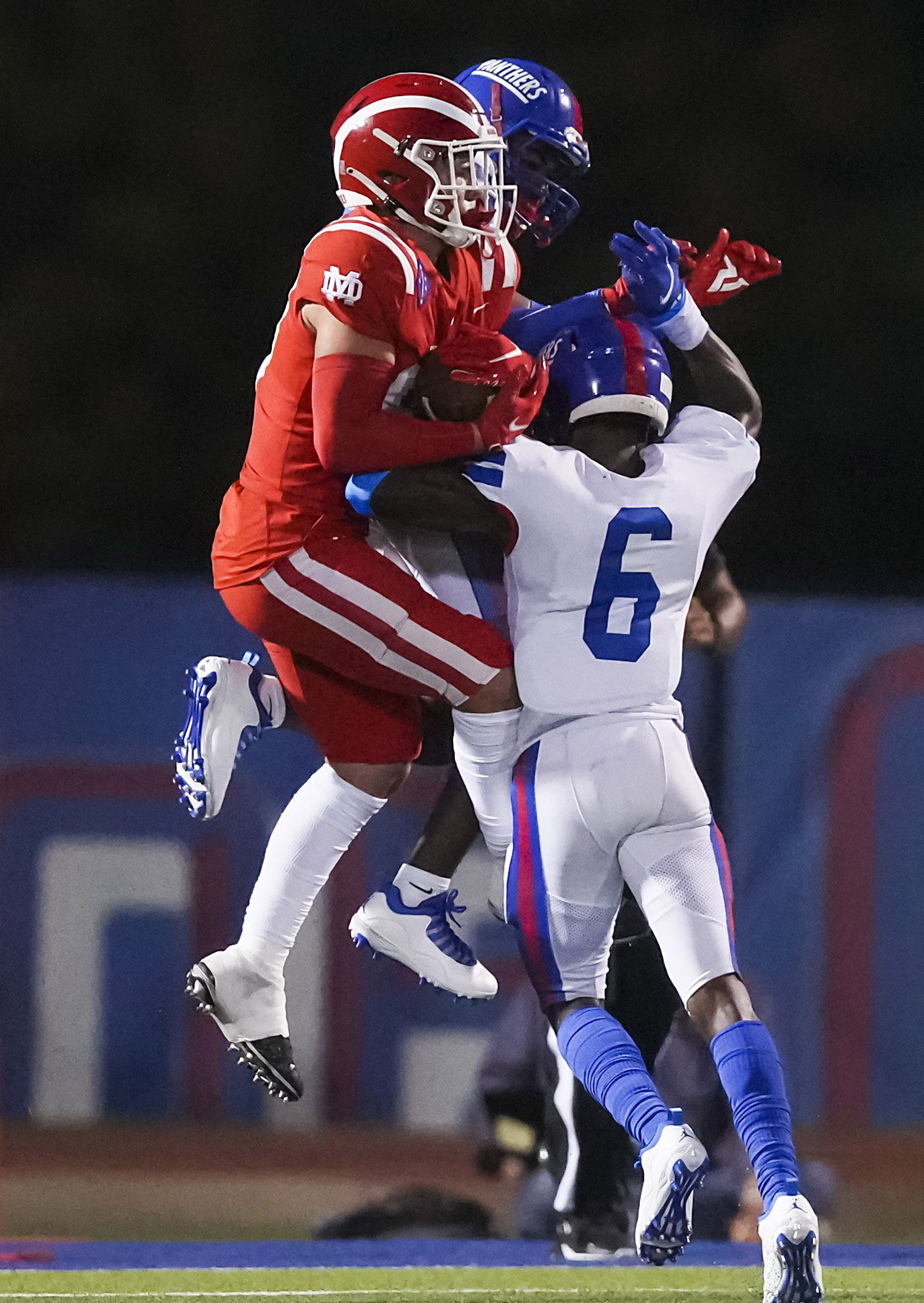 Mater Dei wide receiver Jack Ressler (88) catches a touchdown pass despite the defense from Duncanville defensive back Da'Myrion Colemann (6) and linebacker Vernon Grant (20) during the first half of a high school football game on Friday, Aug. 27, 2021, in Duncanville. (Smiley N. Pool/The Dallas Morning News)