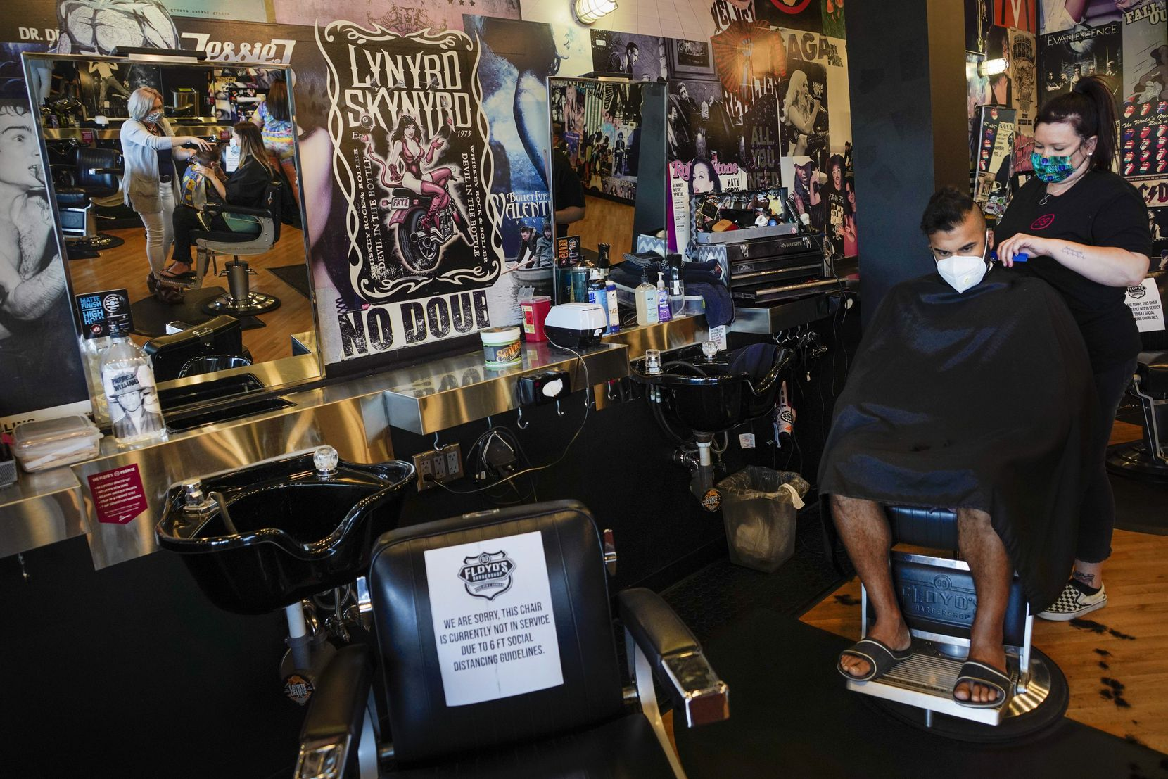 Abid Kabani had his hair cut by stylist Jackie Tomberlin at Floyd's 99 Barbershop in Richardson on May 8, 2020, the first day salons and barber shops were allowed to reopen after a lengthy closure due to the COVID-19 pandemic.