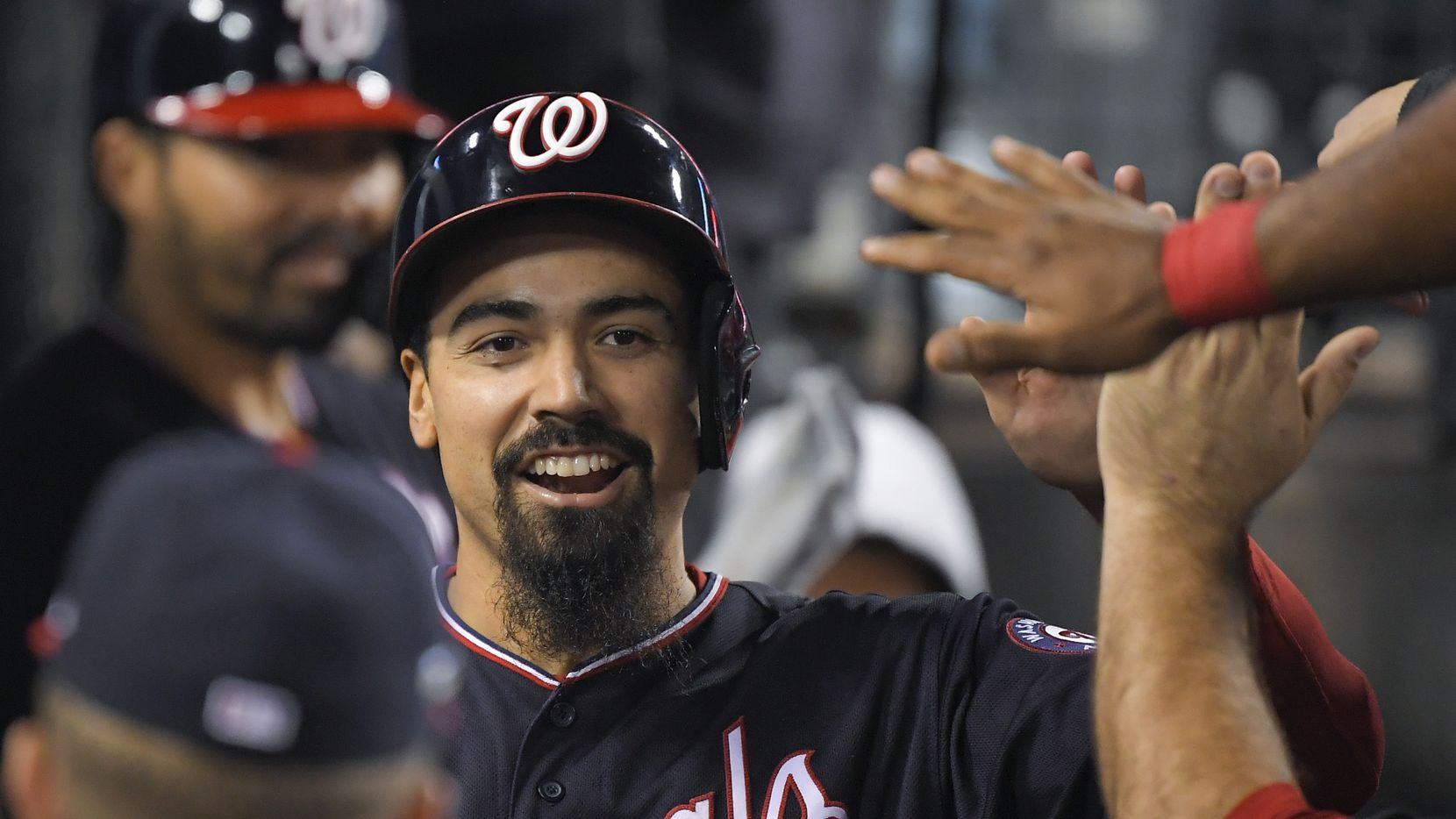 Washington Nationals' Anthony Rendon celebrates in the dugout after scoring on a single by Juan Soto during the sixth inning in Game 5 of the baseball team's National League Division Series against the Los Angeles Dodgers on Wednesday, Oct. 9, 2019, in Los Angeles. (AP Photo/Mark J. Terrill)