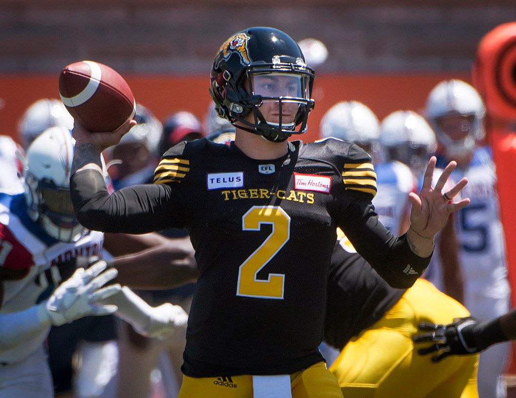 Hamilton Tiger-Cats quarterback Johnny Manziel throws during the first half against the Montreal Alouettes during a Canadian Football League preseason game in Montreal on Saturday, June 9, 2018. (Peter McCabe/The Canadian Press via AP)