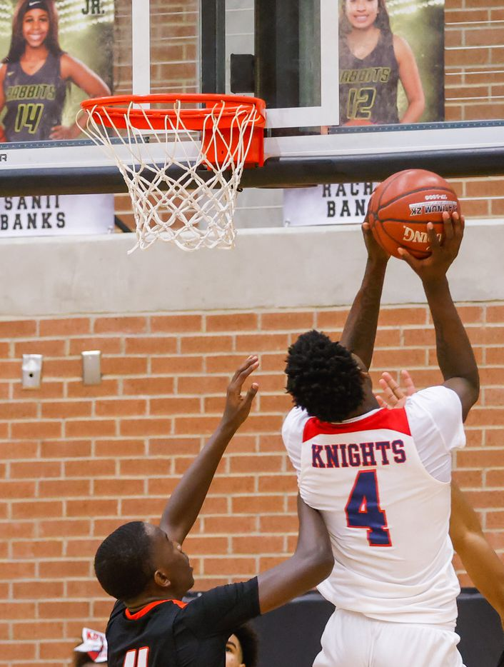 Kimball's Kyron Henderson (4) scores a shot over Lancaster during the overtime of a boys basketball UIL Class 5A Region II playoff game in Forney on Friday, March 5, 2021. (Juan Figueroa/ The Dallas Morning News)