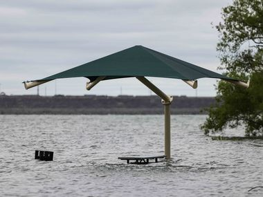 The water level at Grapevine Lake came up to the level of grills along the lake earlier this month. (Lola Gomez/The Dallas Morning News)