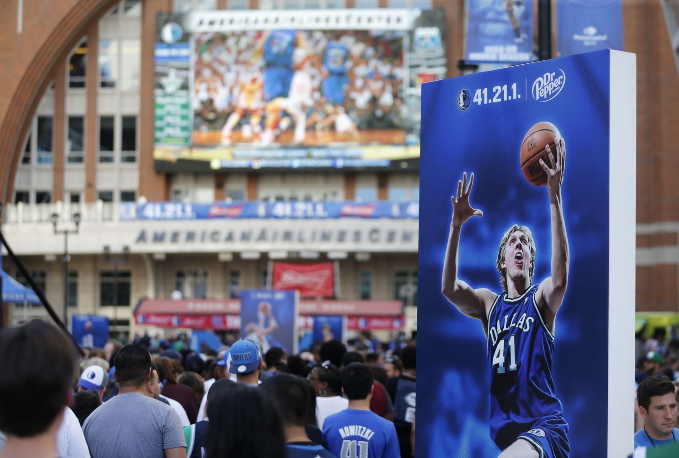 Fans line up to take a portrait at the last home game of the season between the Dallas Mavericks and Phoenix Suns at American Airlines Center in Dallas on Tuesday, April 9, 2019. (Vernon Bryant/The Dallas Morning News)