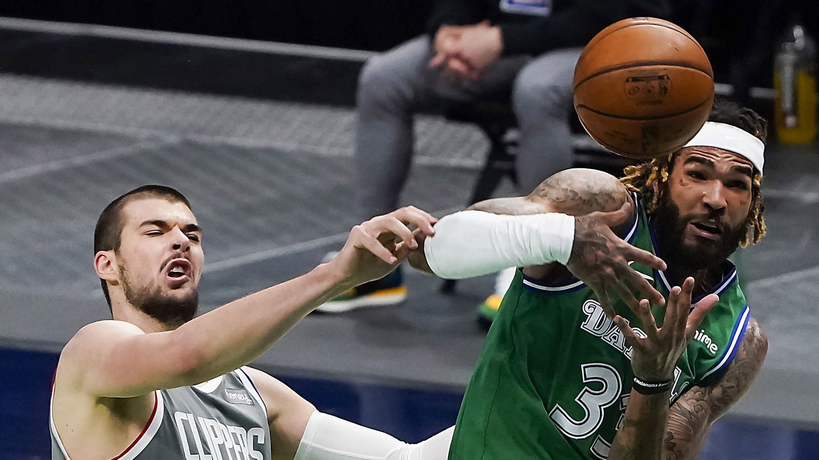 Dallas Mavericks center Willie Cauley-Stein (33) fights for a rebound against LA Clippers center Ivica Zubac (40) during the second quarter of an NBA basketball game at American Airlines Center on Wednesday, March 17, 2021, in Dallas.