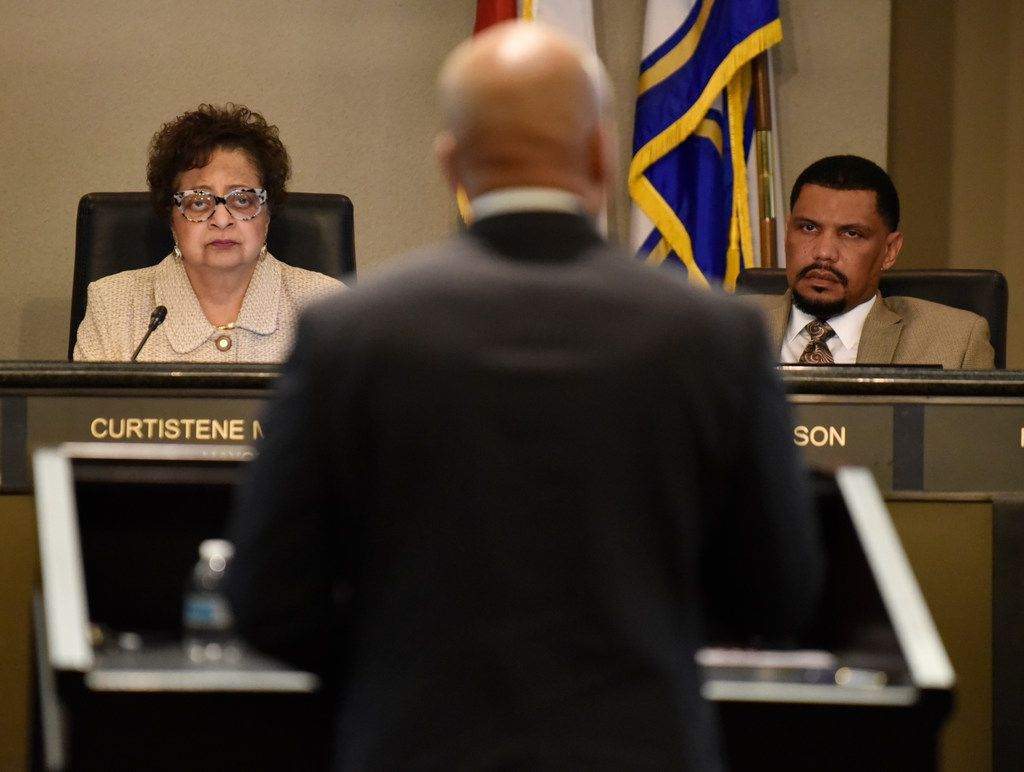 DeSoto Mayor Curtistene Smith McCowan, left, and City Manager Dr. Tarron Richardson, right, listen to Carl Sherman, Jr., president of the DeSoto school board, speak in favor of creating a paid parental leave program for city employees in DeSoto during a city council meeting, Tuesday April 02, 2019 at the Jim Baugh Government Center in DeSoto. The council voted in favor of creating the program to pay city employees for parental leave.