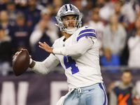 Dallas Cowboys quarterback Dak Prescott (4) sets up a touchdown pass to Dallas Cowboys wide receiver CeeDee Lamb (88) during the fourth quarter of a NFL game against the New England Patriots on Sunday, Oct. 17, 2021, at Gillette Stadium in Foxborough, Mass.