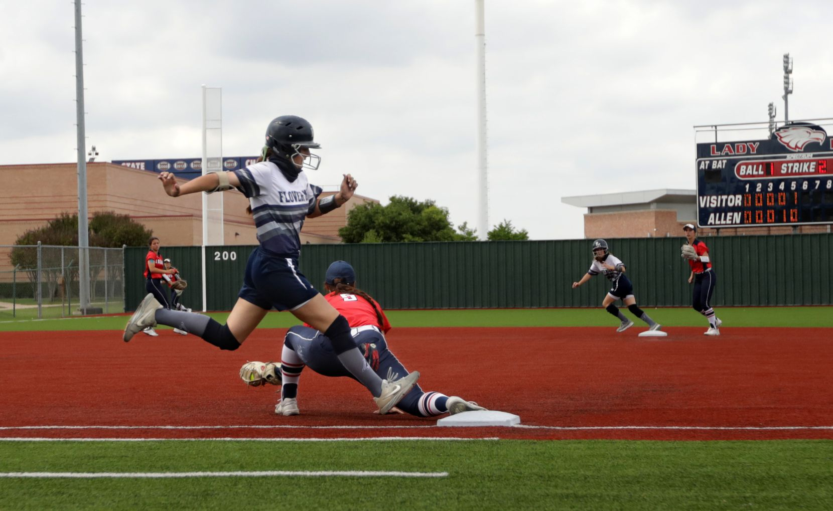 Allen High School player #5, Brooklyn Purtell, takes out Flower Mound High School player #23, Courtney Cogbill, at first base during a softball game at Allen High School in Allen, TX, on May 15, 2021. (Jason Janik/Special Contributor)