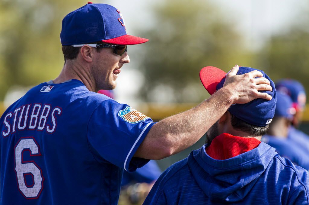 Texas Rangers outfielder Drew Stubbs pats second baseman Rougned Odor on the head during a spring training workout at the team's training facility on Saturday, Feb. 27, 2016, in Surprise, Ariz. (Smiley N. Pool/The Dallas Morning News)