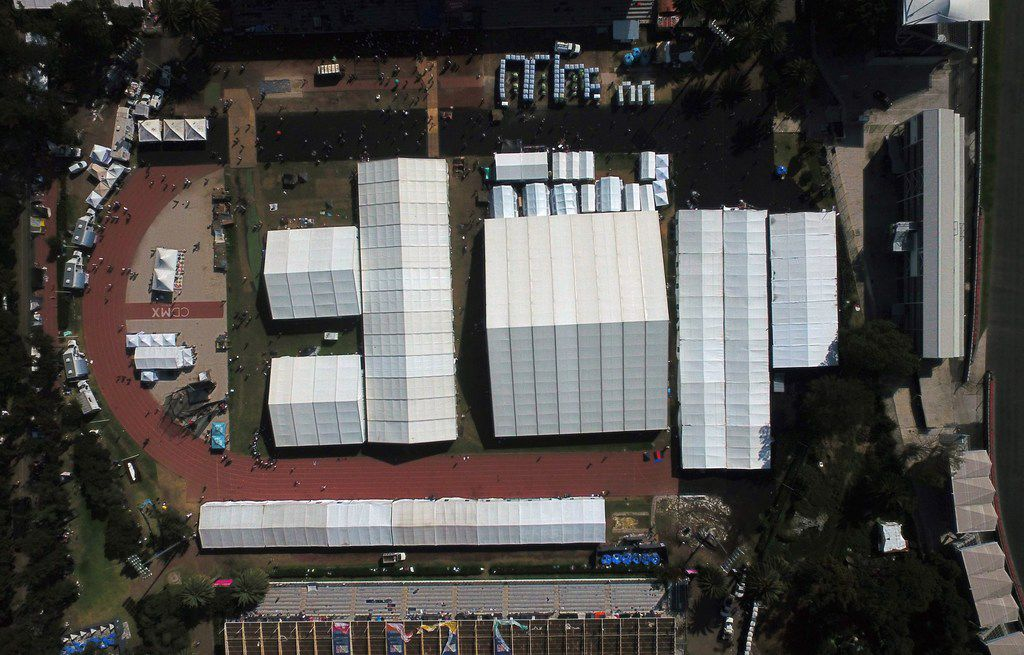 Aerial view of a temporary shelter set up for a migrant caravan of Central Americans heading to the US at the Sports City in Mexico City on November 9, 2018.
