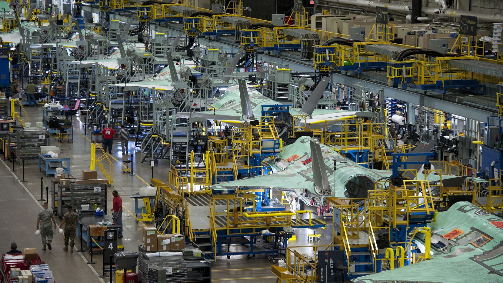 F-35 Lightning II jets being manufactured at Lockheed Martin's facility in Fort Worth, Texas.Lockheed Martin Fort Worth Texas Photo by Alexander H Groves  Production Line from Monorail   FP170764   1707383  JSF  F-35  AF Plant 4  04_06_17  Leeya Davis  Image has NOT been released  FOUO  FOR OFFICIAL USE ONLY