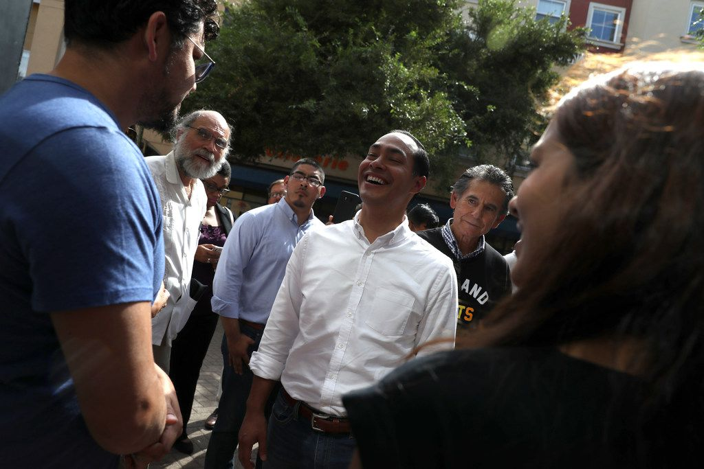 Former U.S. Housing Secretary Julian Castro greets business owners while touring a housing development Sept. 25, 2019, in Oakland, Calif. Castro has released a housing plan that he says would end homelessness by 2028 nationwide.