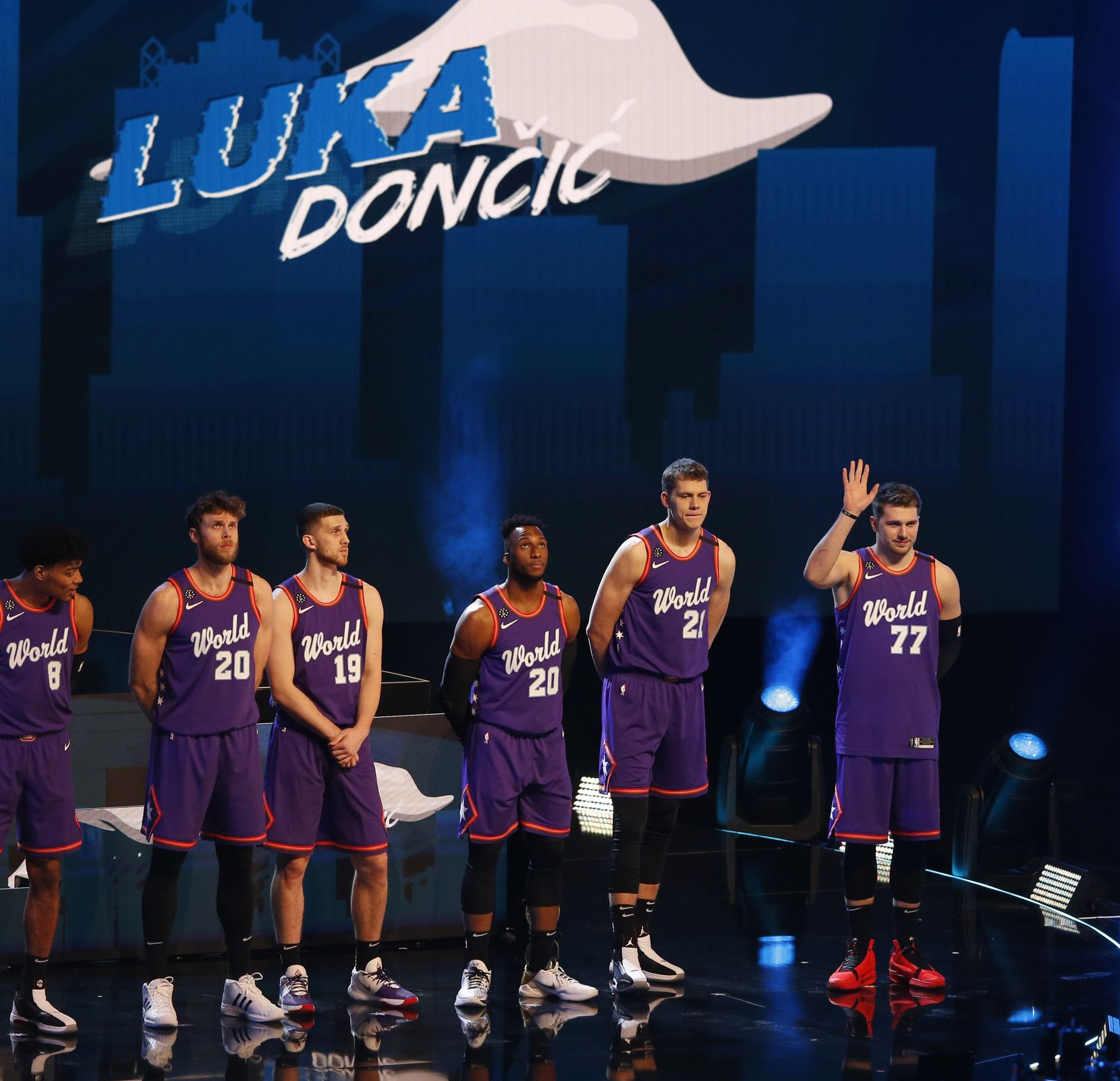 Dallas Mavericks Luka Doncic waves as he is introduced on the World Team before the NBA Rising Stars game during the NBA All-Star 2020 at United Center in Chicago on Friday, February 14, 2020.