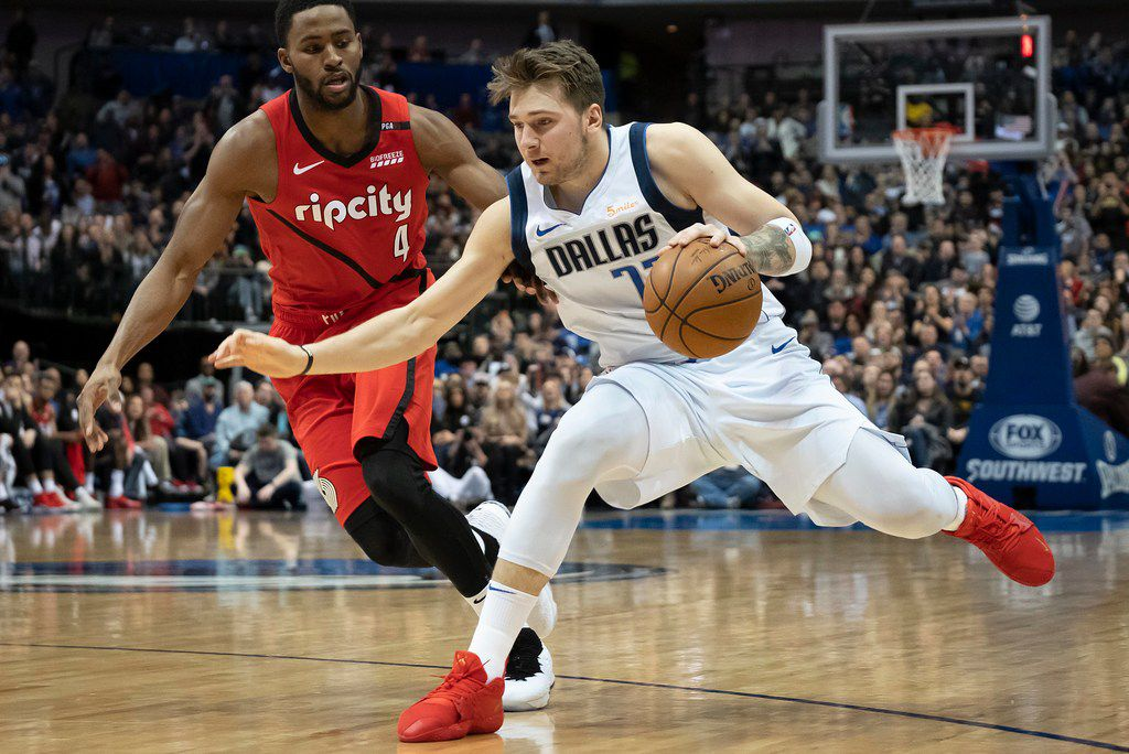 Dallas Mavericks forward Luka Doncic (77) drives past Portland Trail Blazers forward Maurice Harkless (4) during the second half of an NBA basketball game at American Airlines Center on Sunday, Feb. 10, 2019, in Dallas. (Smiley N. Pool/The Dallas Morning News)