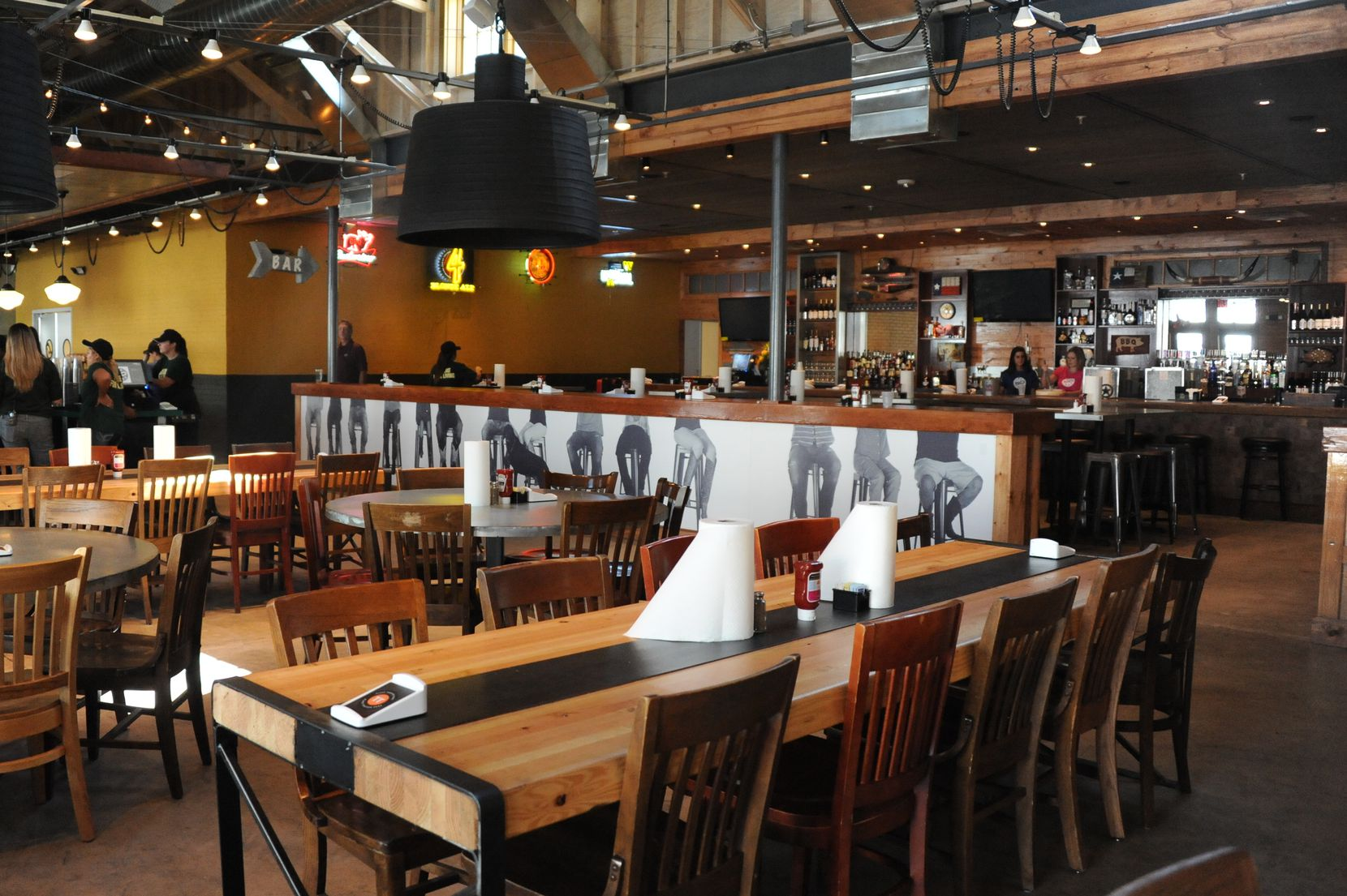 The cavernous barbecue joint has four seating areas -- a bar, two dining areas and a back room that can be reserved for parties.
