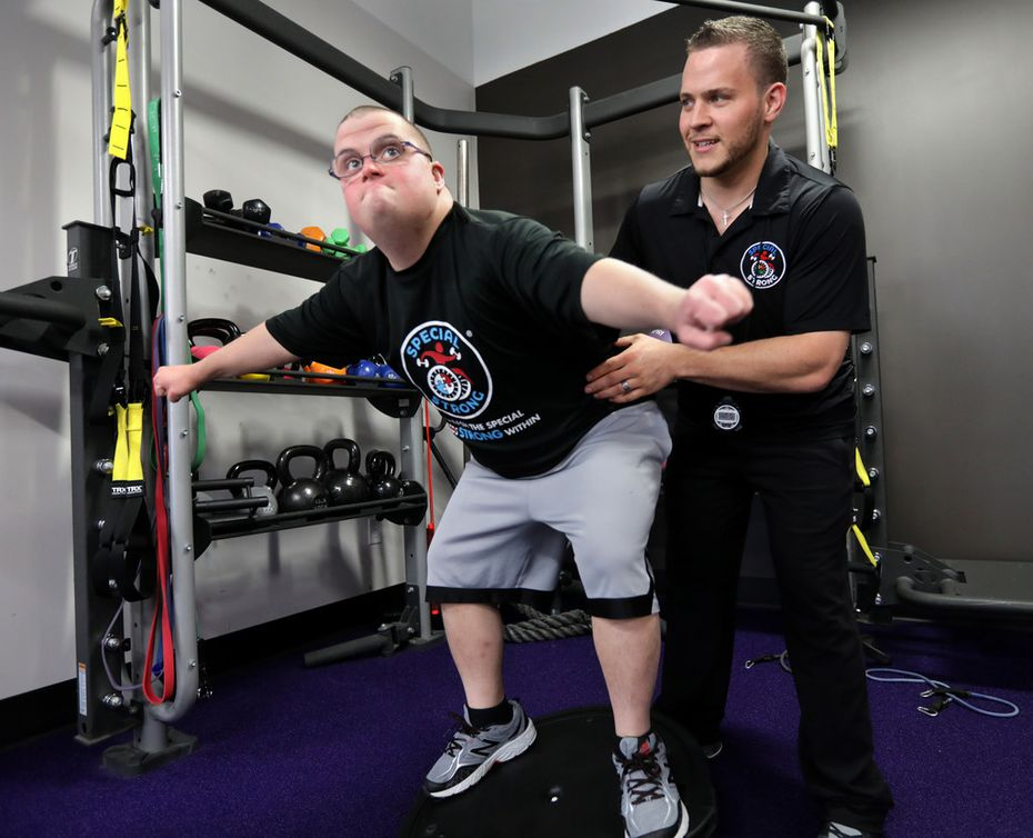 Josh Walters, who is 28 and has Down syndrome, has regained interest in life after working with Special Strong, the fitness company for special needs started by Daniel Stein (right).