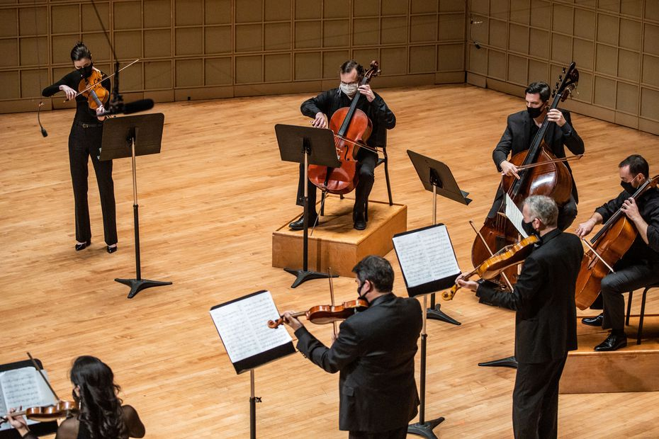 Members of the Dallas Symphony Orchestra perform 'Last Round' by Osvaldo Golijov as part of the Dallas Chamber Music Society concert at the Morton H. Meyerson Symphony Center in Dallas on Nov. 16.